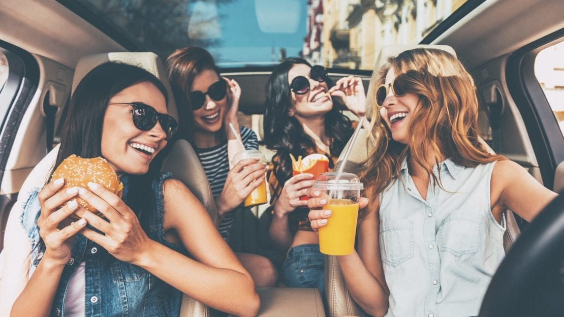 Young Girls Driving While Distracted Stock Photo
