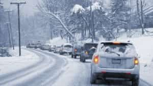 Stock photo of a line of traffic on a snowy road