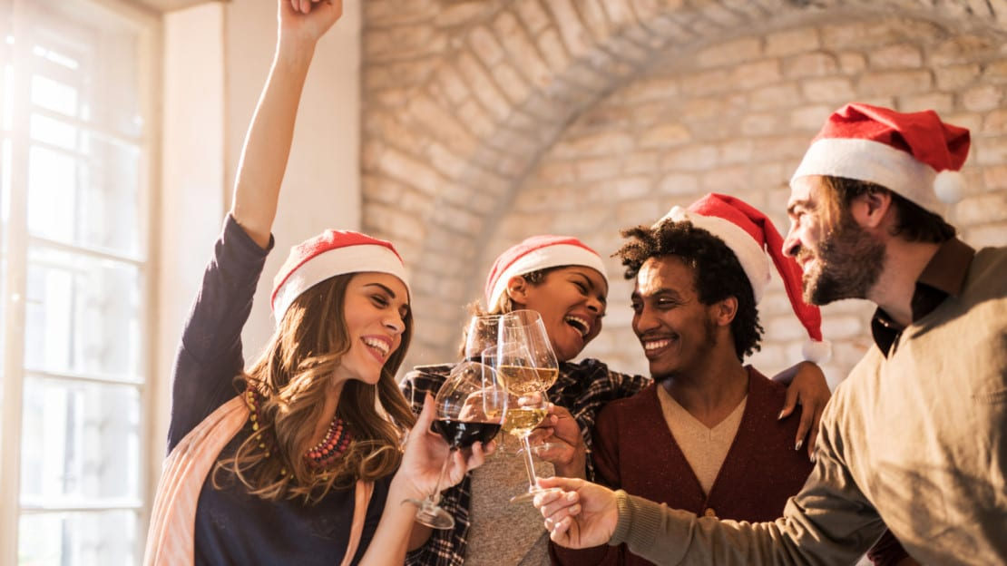 Friends Making A Toast At A Christmas Party Stock Photo