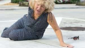 Elderly Woman Slipping and Falling Stock Photo