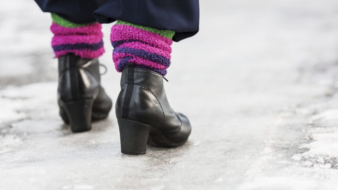 Woman Walking On An Icy Surface Stock Photo