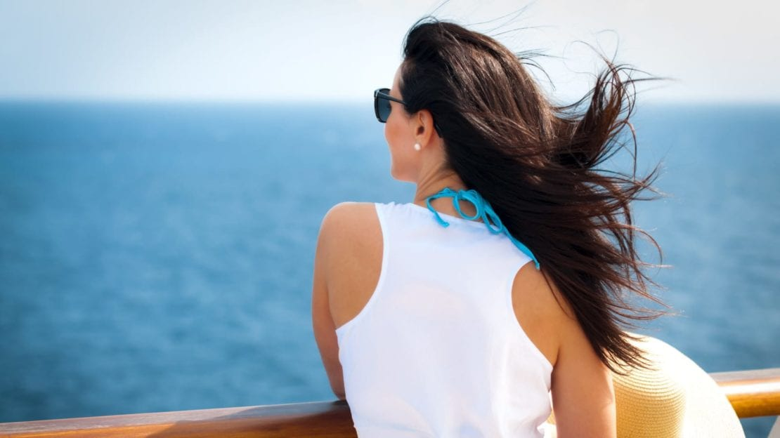 Woman Viewing The Ocean From A Cruise Ship Stock Photo