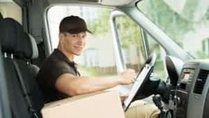 Delivery Driver Driving A Delivery Van Stock Photo