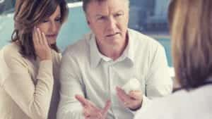 Mature Couple Meeting With Doctor Privately Stock Photo