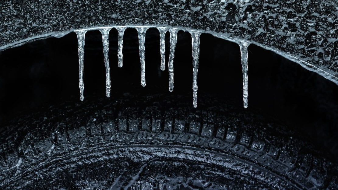 Frozen Wheel Well and Tire Stock Photo