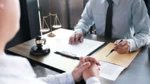 Lawyer Meeting With A Client In His Office Stock Photo