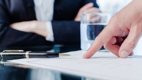 Lawyer Instructing Client Where To Sign On Document