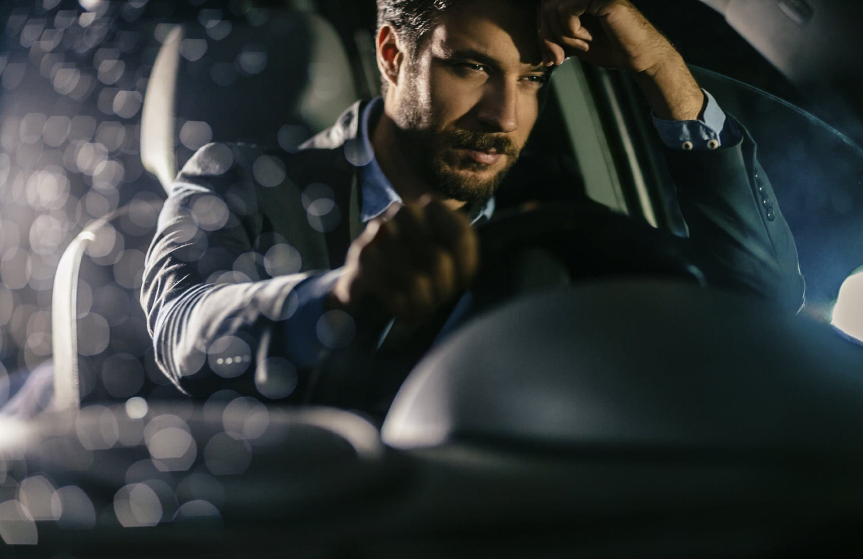 Man Driving With Worried Look On His Face Stock Photo