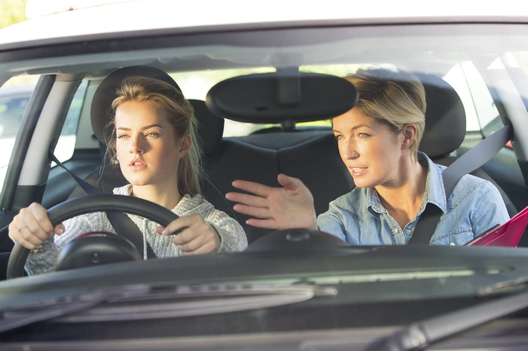 Mother Giving Daughter Driving Lessons Stock Photo
