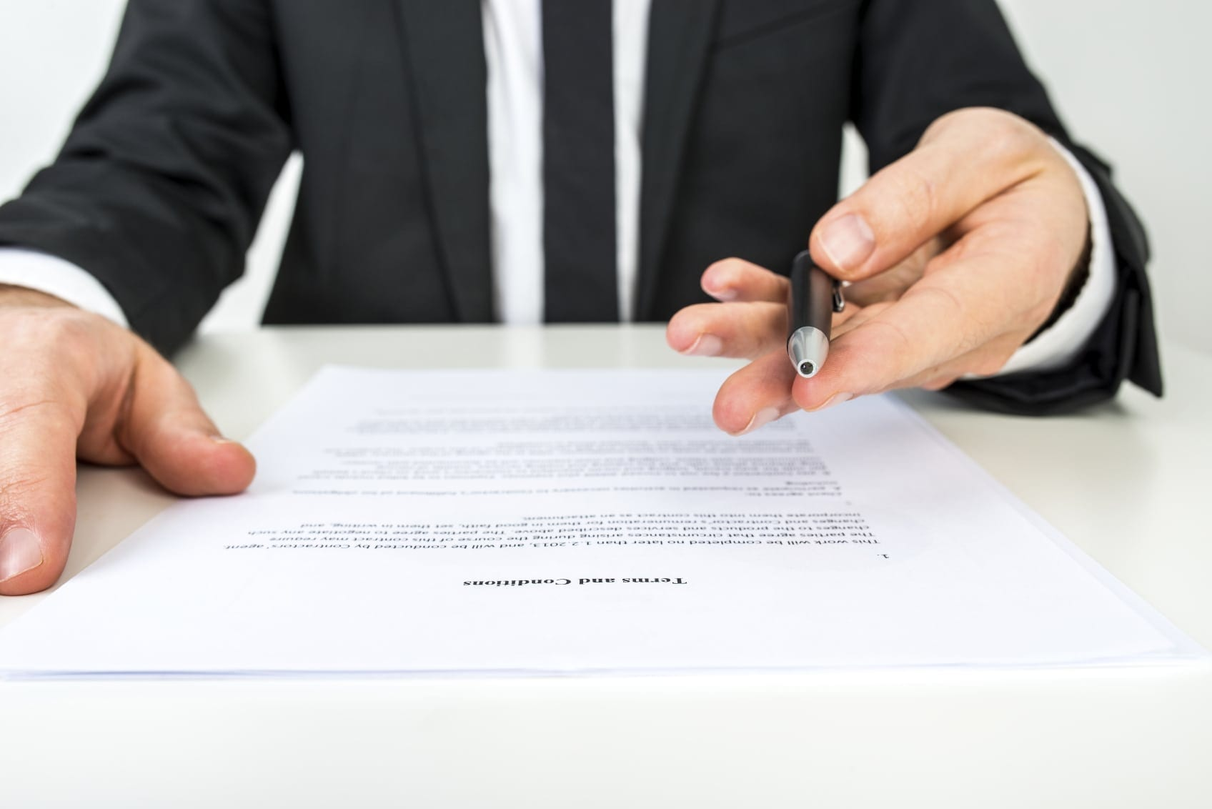 Lawyer Asking Client To Sign Legal Document Stock Photo