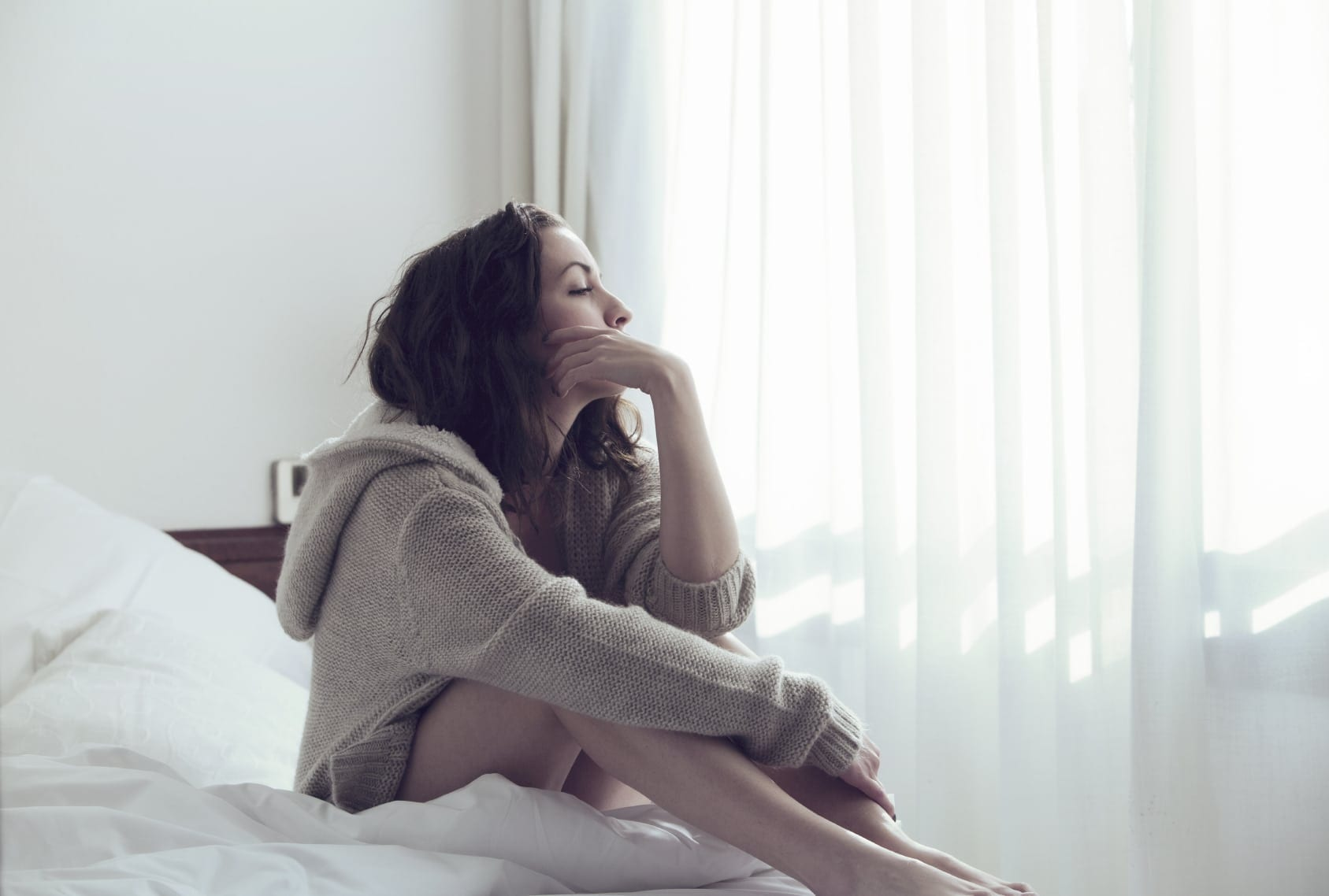 Young Woman In Deep Thought Stock Photo
