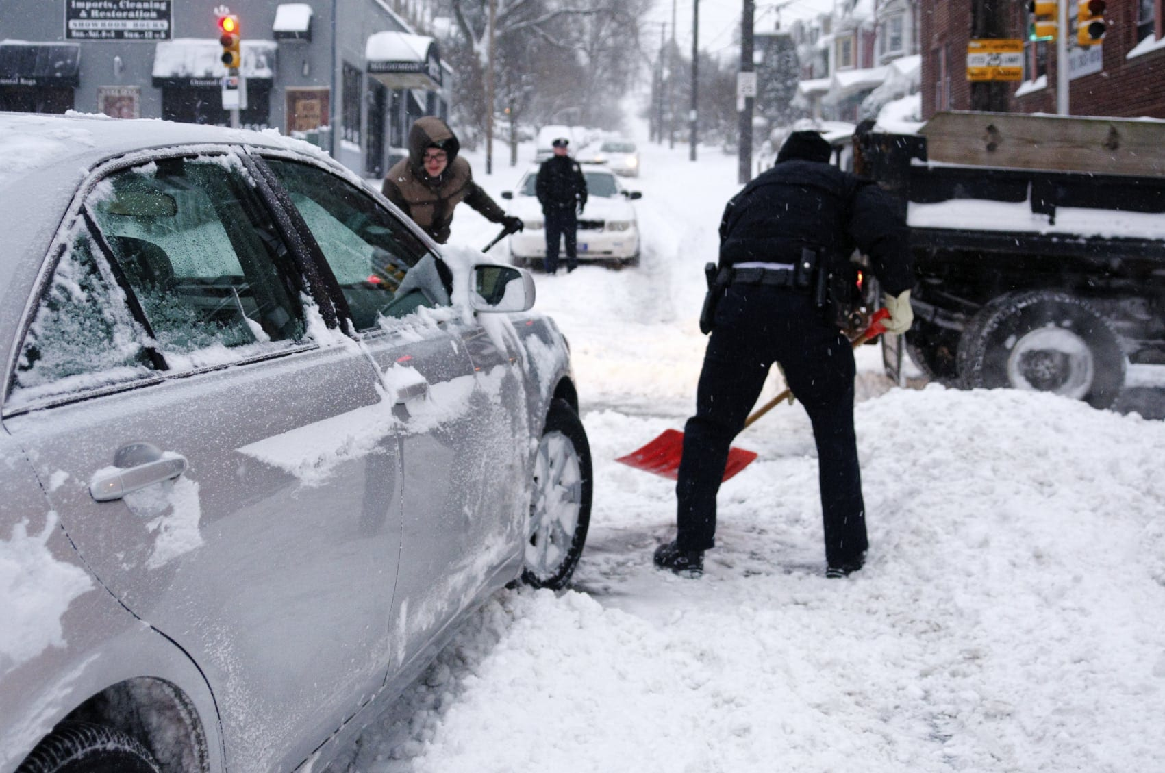 Police Officers Shoveling Snow Stock Photo