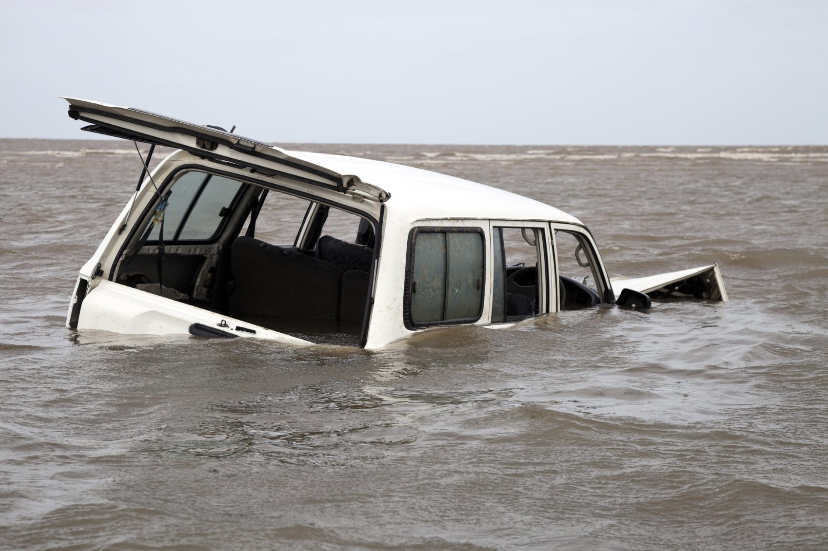 White SUV Submerged In Water Stock Photo