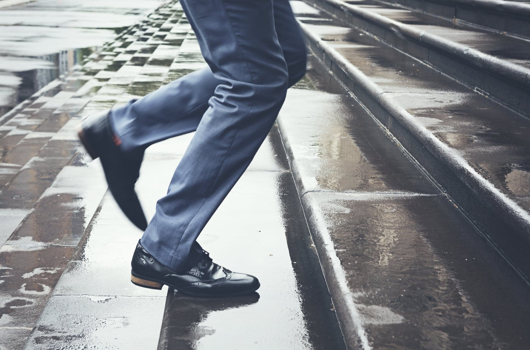 Male Walking Up A Set Of Steps Stock Photo