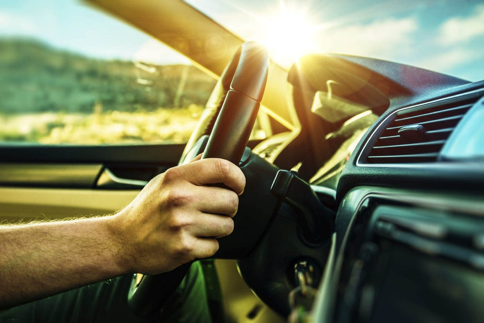 Male Driver With Hand On Steering Wheel Stock Photo