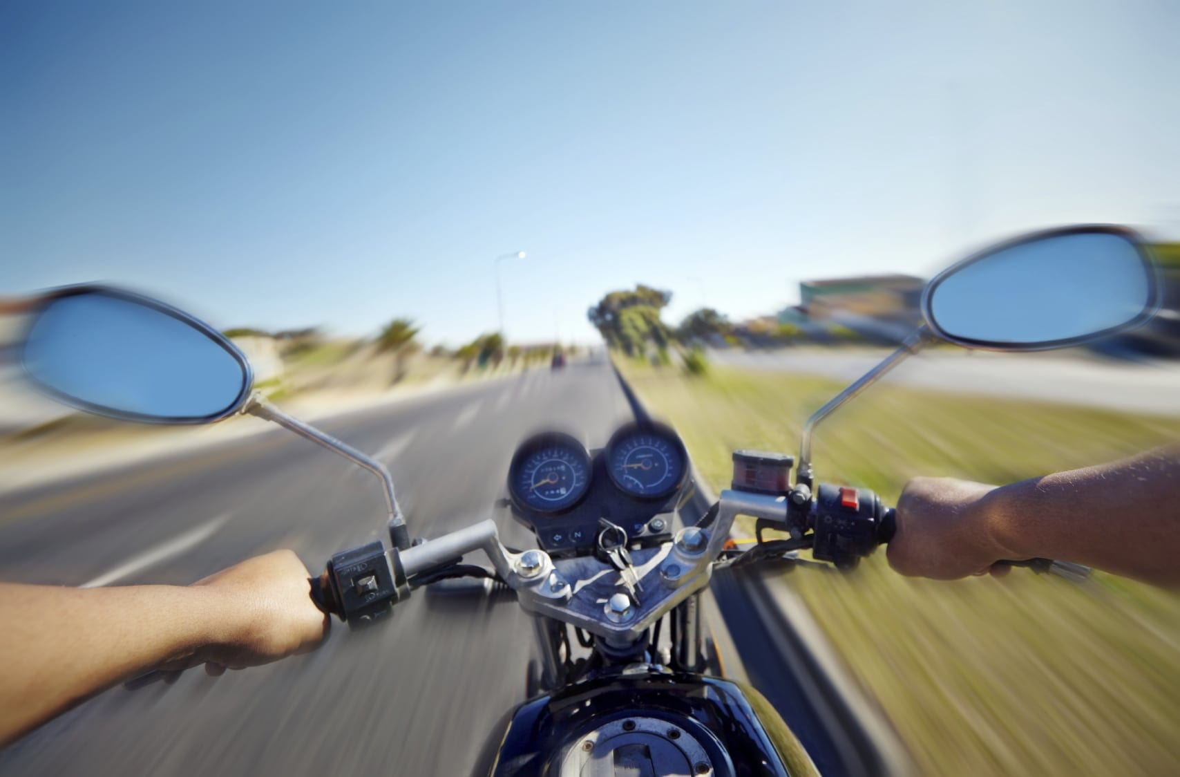 Motorcyclist Riding Motorcycle During The Day Stock Photo