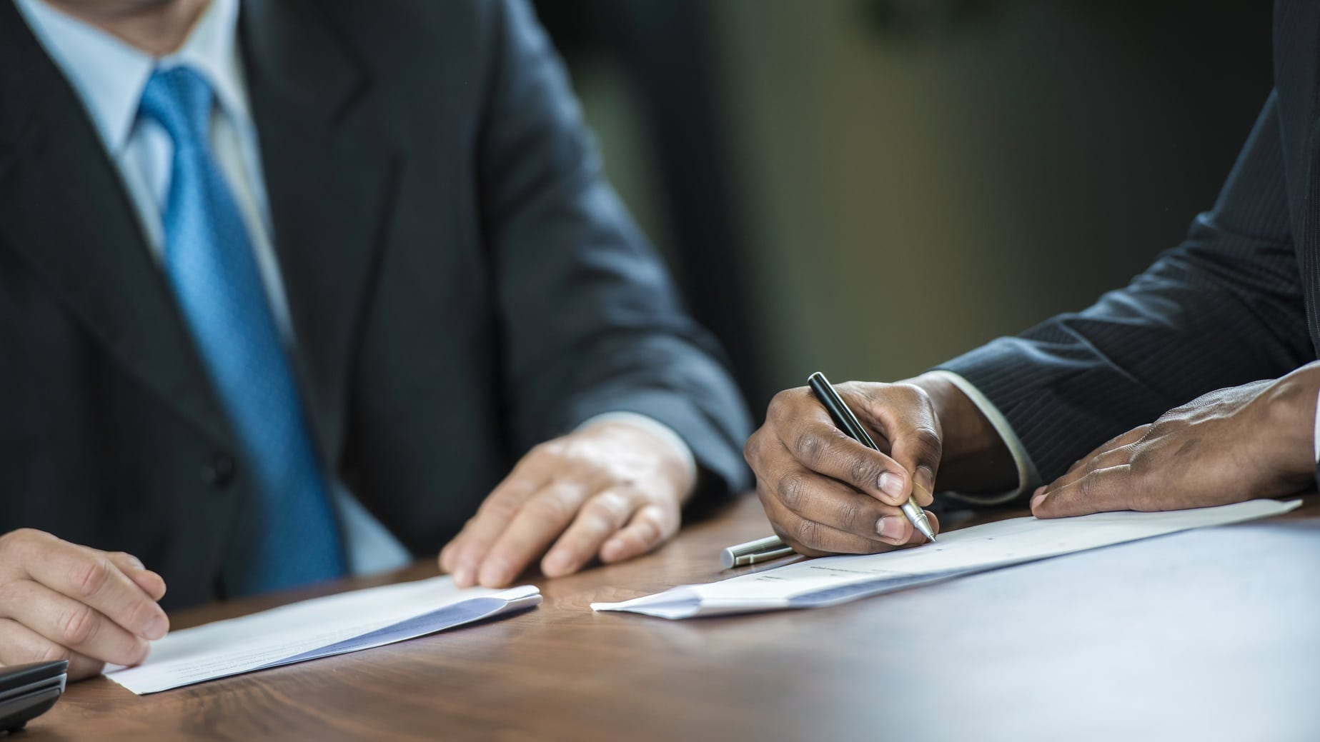 Lawyer Signing A Legal Document Stock Photo
