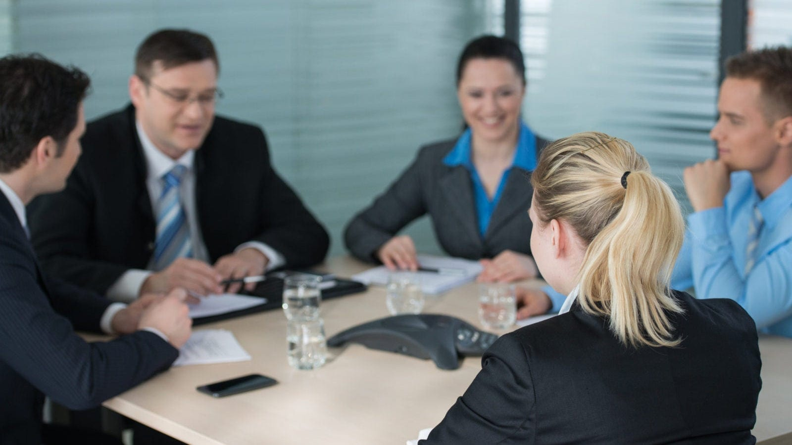 Lawyers Meeting Privately Inside A Boardroom Stock Photo