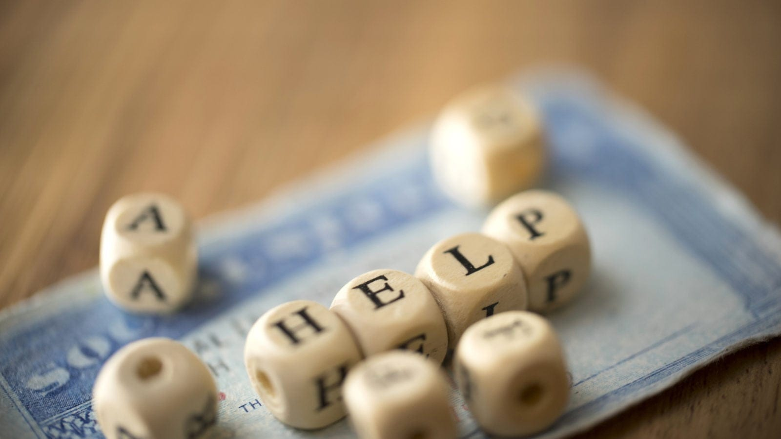 Scrabble Pieces On Top Of A Social Security Card Stock Photo