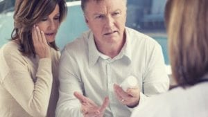Mature Married Couple Meeting With A Doctor Stock Photo