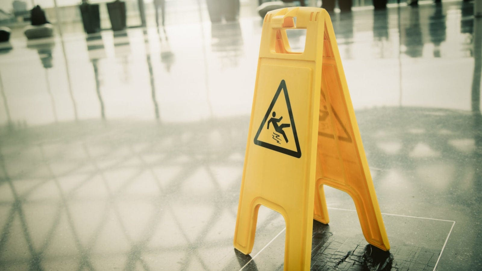slip and fall sign on wet floor