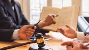Attorneys Reading Law Book Stock Photo