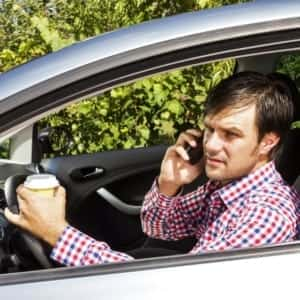 Distracted Driver Talking On Cell Phone Stock Photo