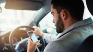 Millenial Texting While Driving Stock Photo