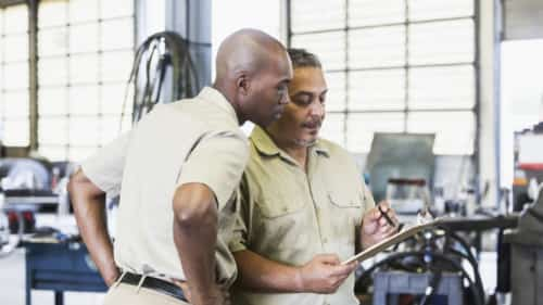 Workers In A Truck Repair Shop Stock Photo