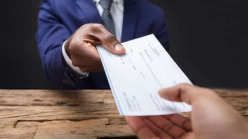 Lawyer Handing Settlement Check To Client Stock Photo