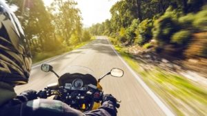 Motorcyclist Riding On A Rural Road Stock Photo