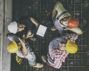 Female architect with three consruction workers on a construction site