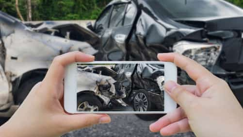 Documenting Car Accident Stock Photo
