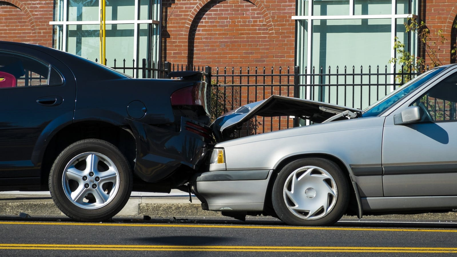 Rear ended auto accident involving two cars on a city street
