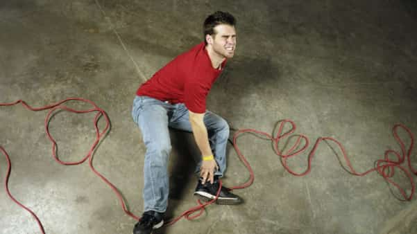Young Man With Ankle Injury Stock Photo