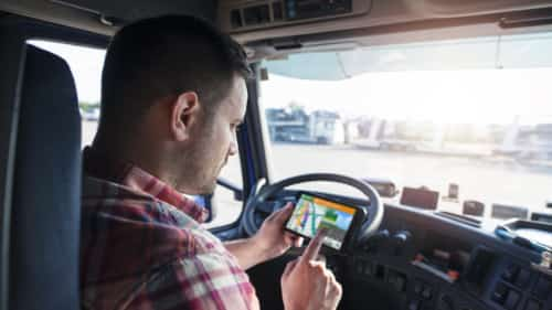 Truck Driver Using GPS System In Cab