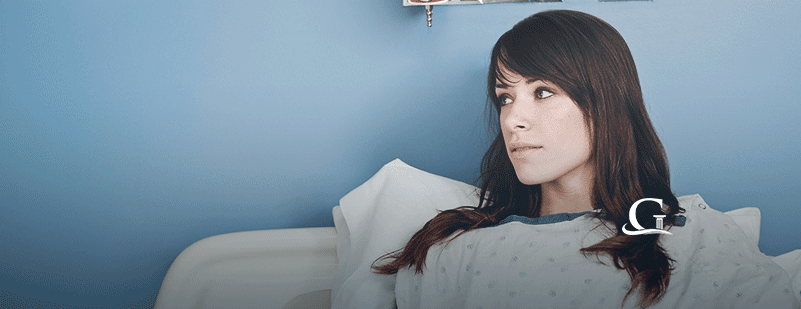 Female Patient In A Hospital Bed Stock Photo