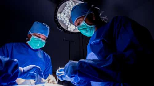 Surgeons Performing Surgery In The Operating Room