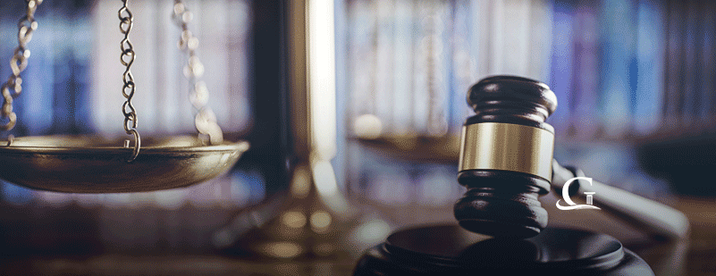 Wooden Gavel Next To Scales Of Justice Stock Photo
