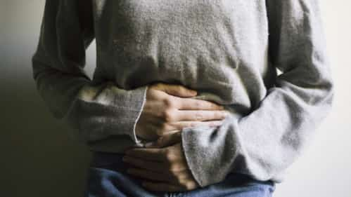 Young Woman With Stomach Pain Stock Photo