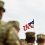 American Soldiers Saluting The Flag Stock Photo