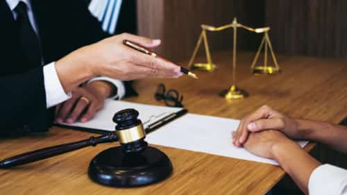 Lawyer Meeting With A Client Privately Stock Photo
