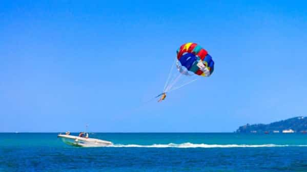 Parasailing On The Ocean Stock Photo