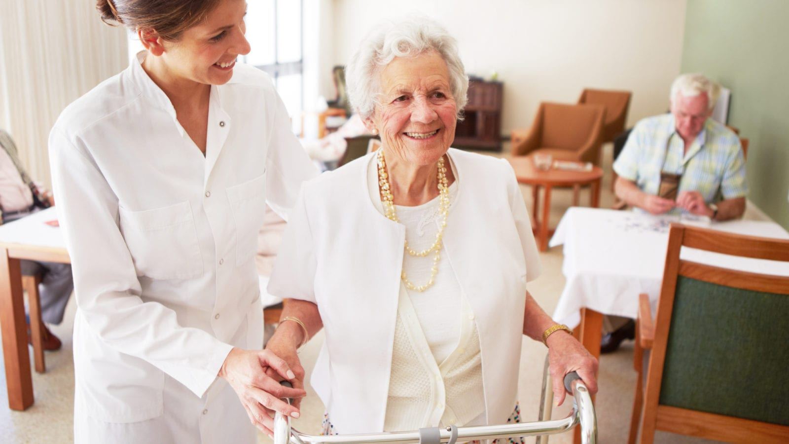 Caregiver Elderly Woman With Walker Stock Photo