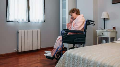 Elderly Woman Sitting By Her Lonesome Stock Photo