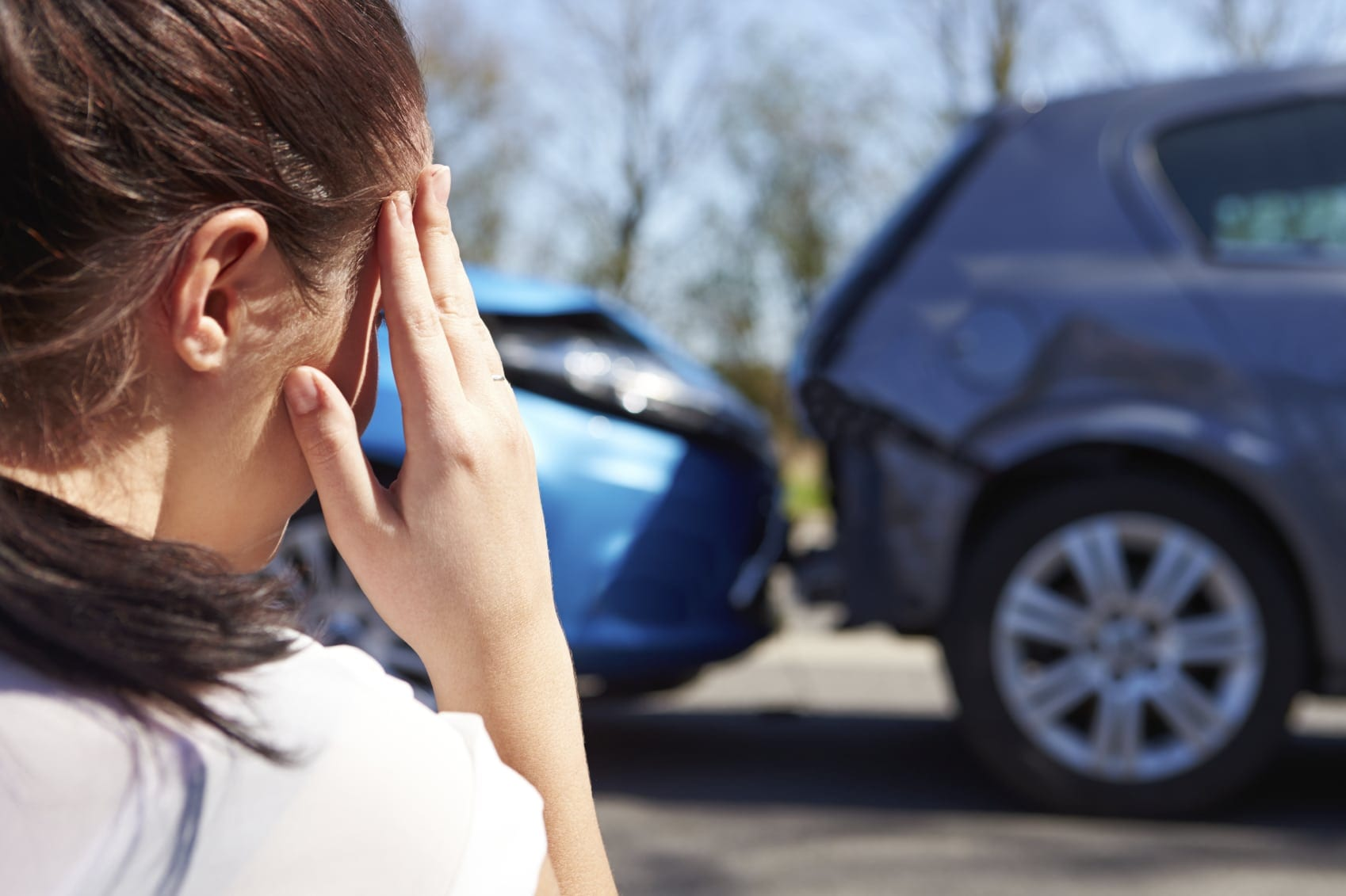 Young Woman In Distress After Car Accident Stock Photo
