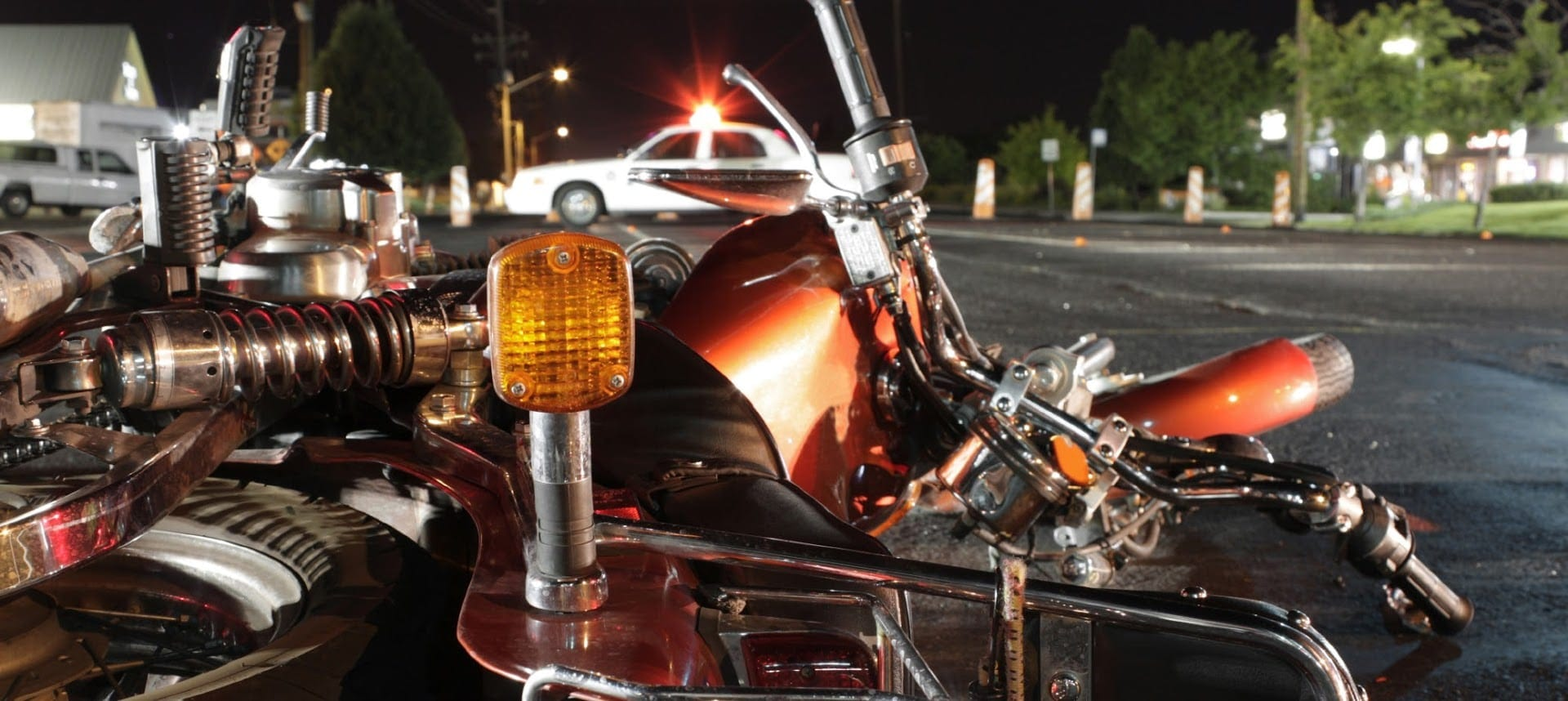Motorcycle Accident On A City Street At Night Stock Photo