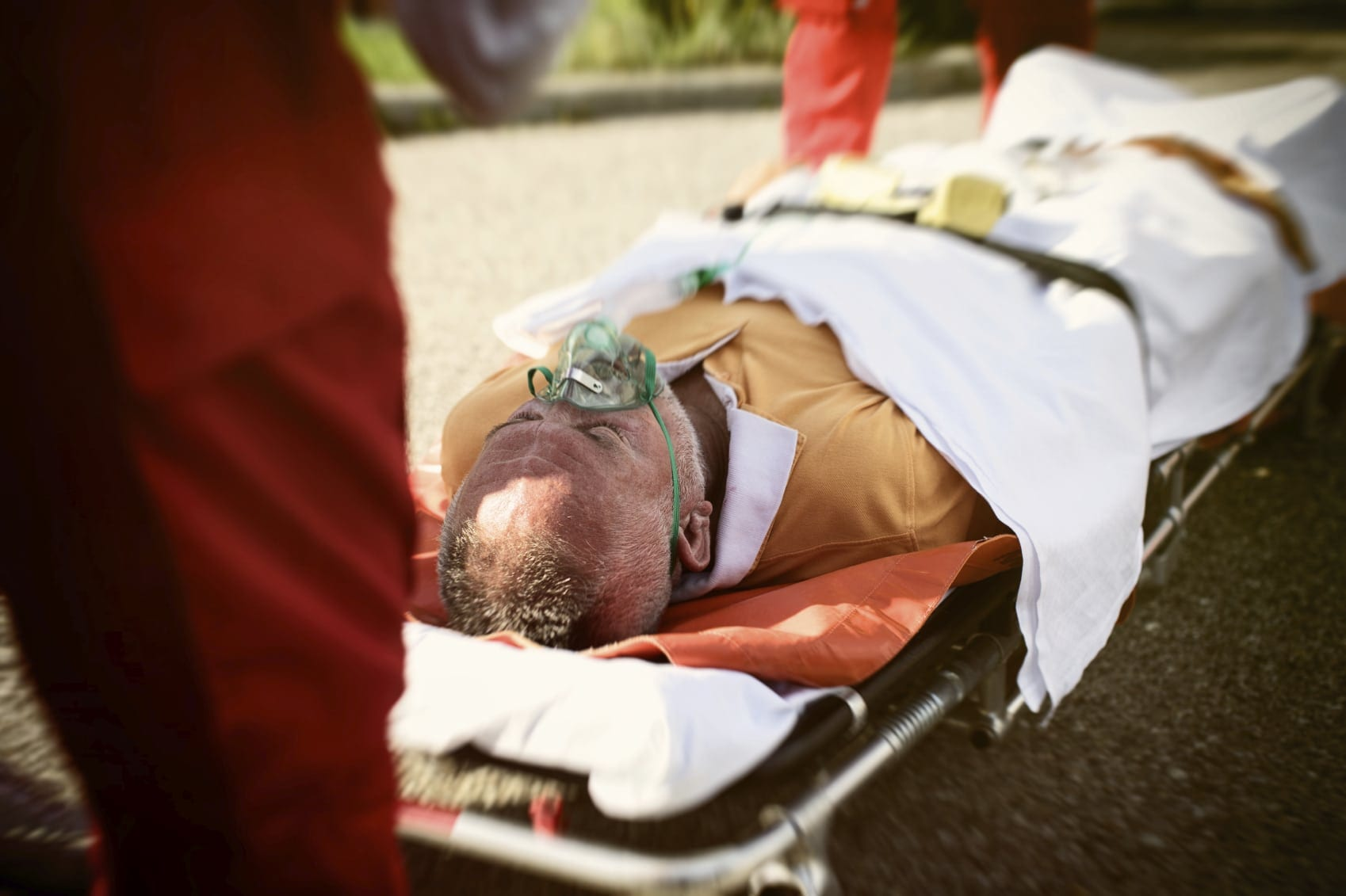 Elderly Man Being Loaded On A Stretcher Stock Photo