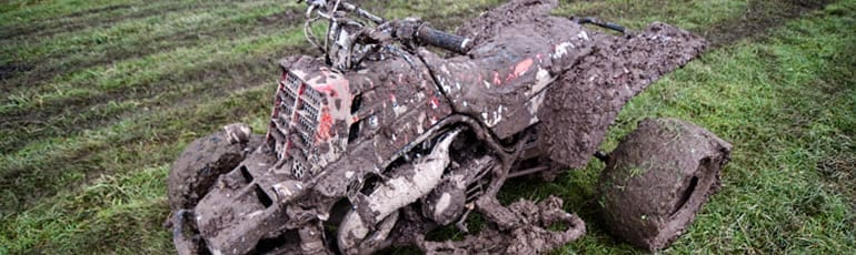 ATV Covered In Mud Stock Photo