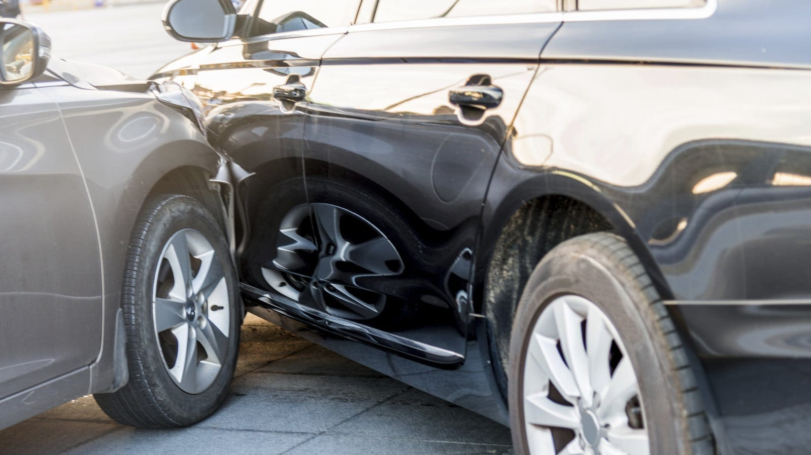 Auto Accident Between Black and Gray Car Stock Photo